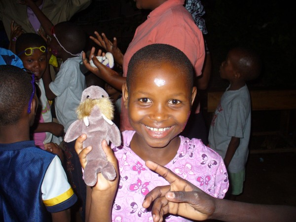 girl with doll at the Majengo Orphanage, Tanzania